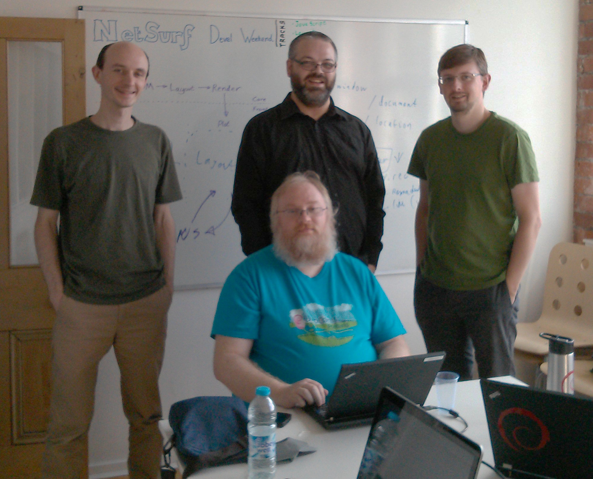Michael Drake, Vincent Sanders, John-Mark Bell and Daniel Silverstone at the Codethink manchester offices